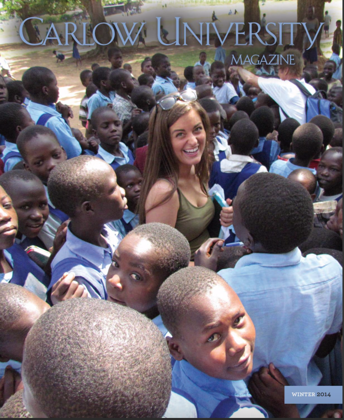 Emily Atheson with youth from one of the eight orphanages visited, she was instrumental in assisting Kyle Holbrook in several murals throughout Uganda with youth many of whom had mental and or physical disabilities.