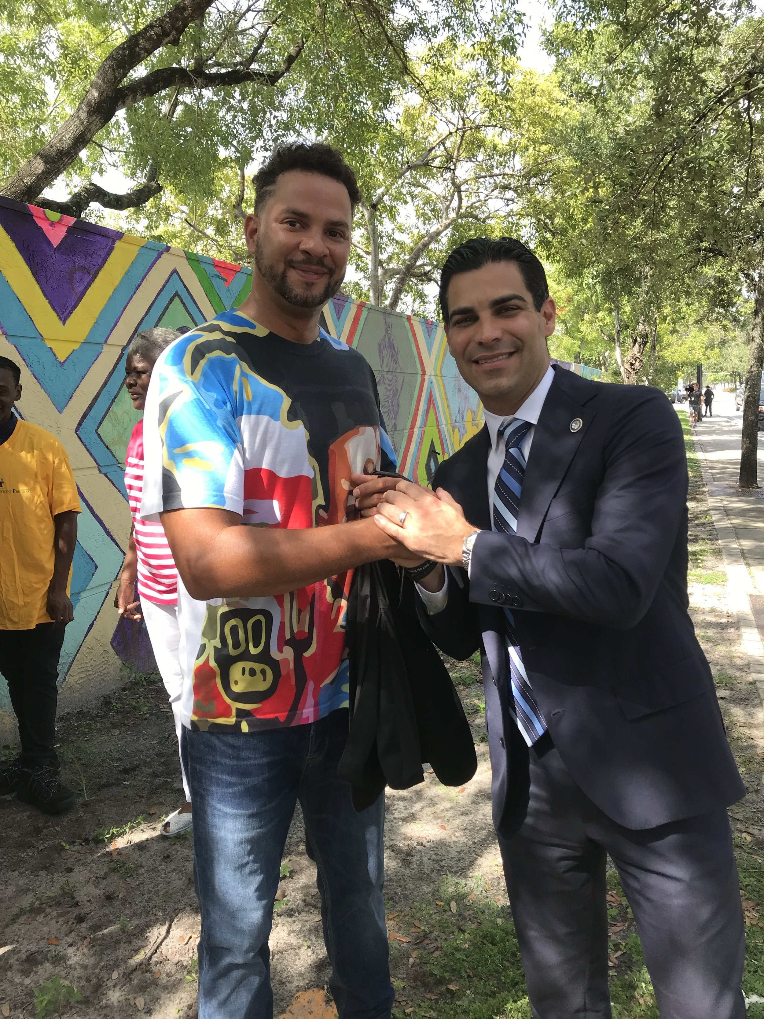 """Mayor Suarez and Kyle Holbrook - """"Some walls tear us apart this wall brings people together"""""""