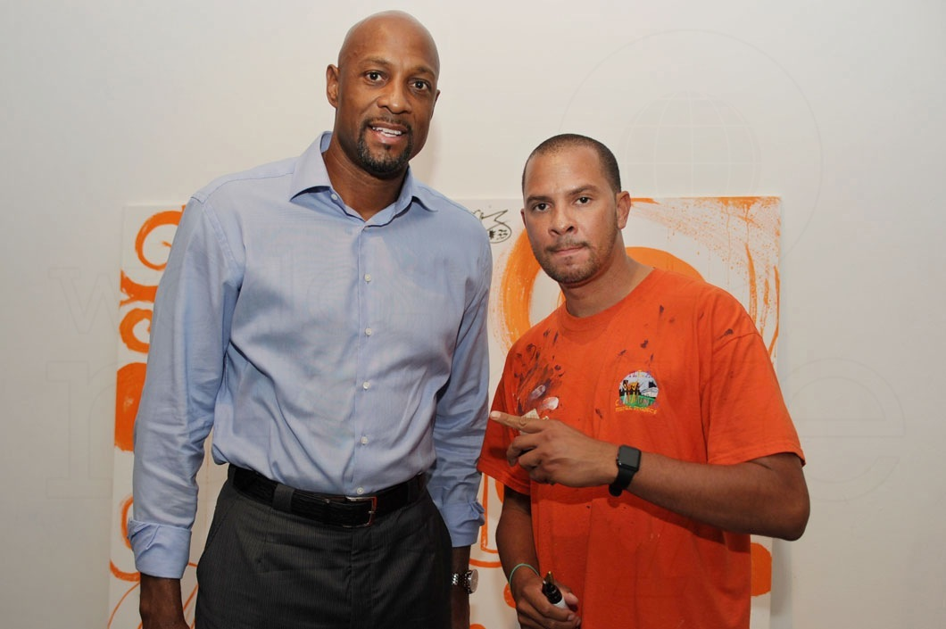 Artworld! - Kyle Holbrook and Alonzo Mourning at Juwan Howard's Juice Foundation event mural.Lil Baby Artworld and many celebrities signed the mural to auction for cancer research.