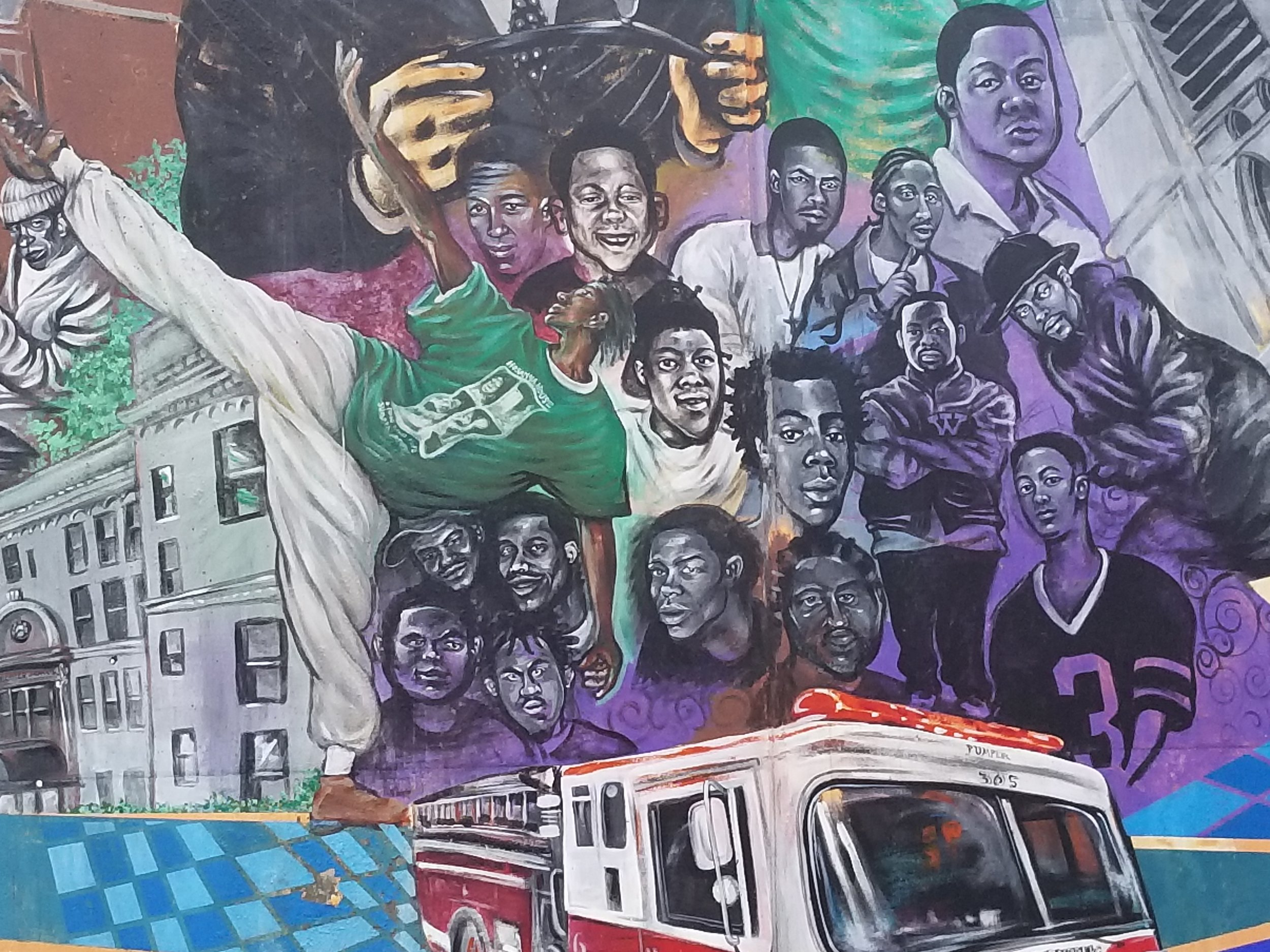 """2003 """"Wilkinsburg History"""" Penn Ave. mural (detail) of 17 of Executive Artist Kyle Holbrook's childhood friends who died from Gun Violence."""