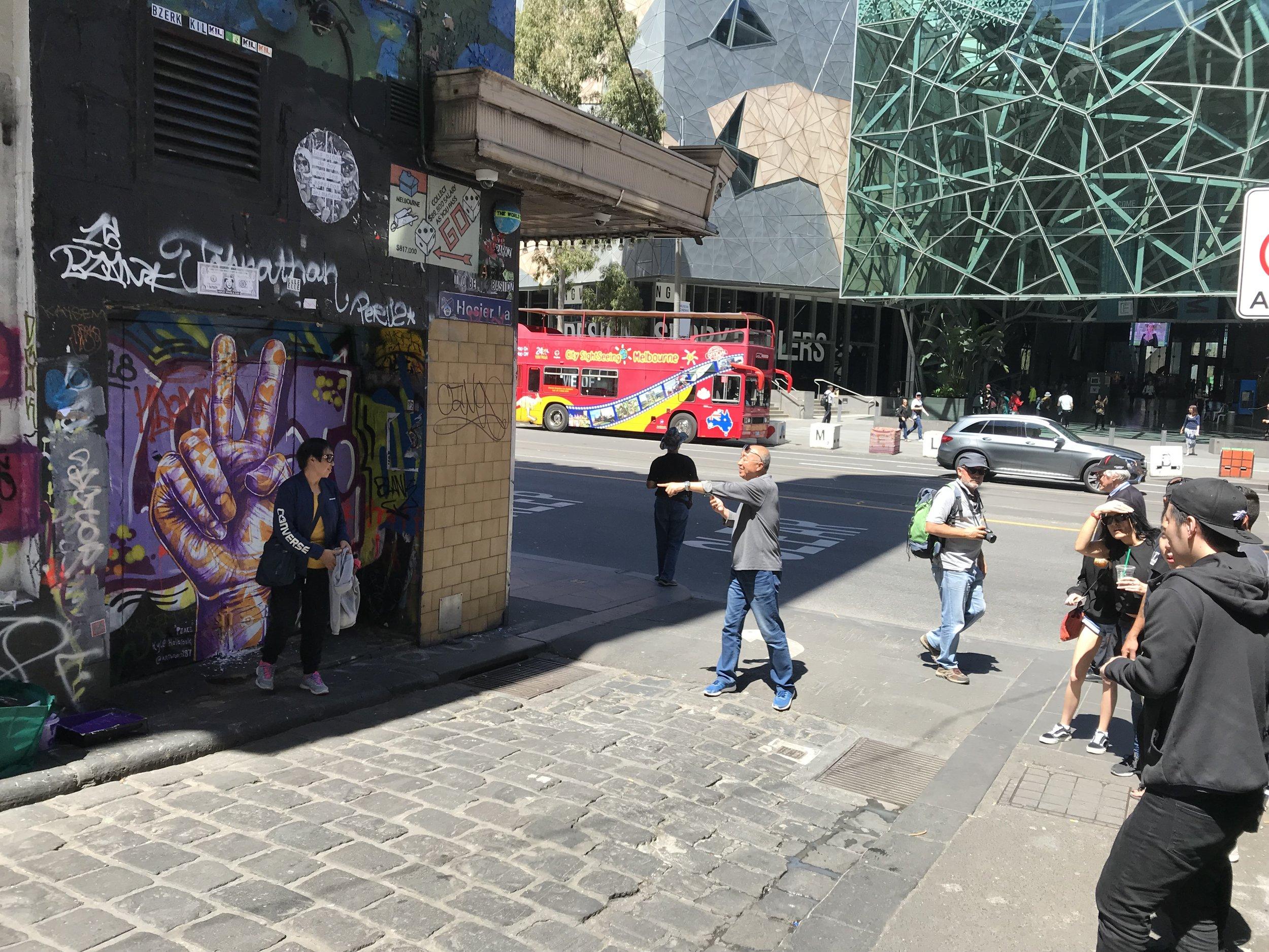 "Hozier Lane tourists - A Street Art Mecca, Kyle Holbrook ""Peace"" mural tour"