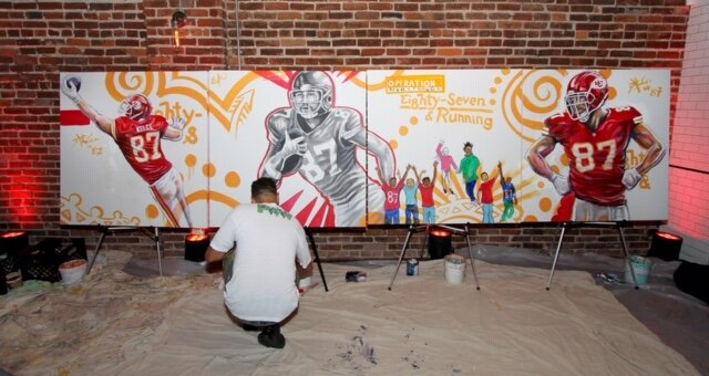 """Live Mural in progress at this fashionable charity Event. Kyle said """" Travis talks with this kids like an older cousin or something, the entire 87 and Running team are genuine good people, its really great how they involve several players with the community."""""""