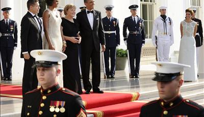 US President Barack Obama and first lady Michelle Obama welcome German Chancellor Angela Merkel in Washington