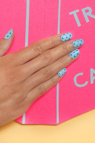 refinery29 blue polka dot manicure idea