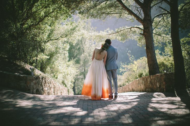 bride and groom outdoors from the back