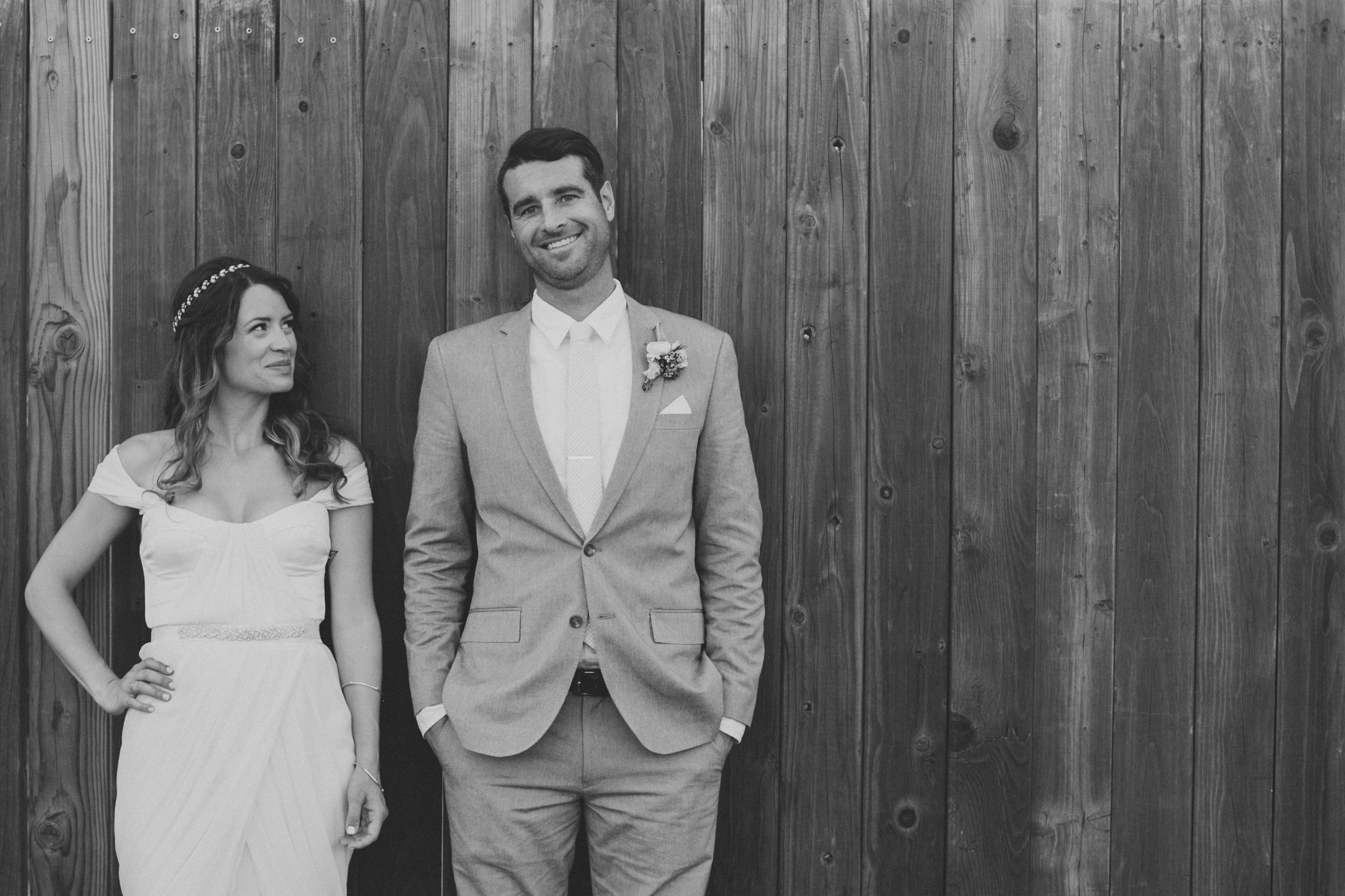 bride in winifred bean tulipe dress, groom in grey suit
