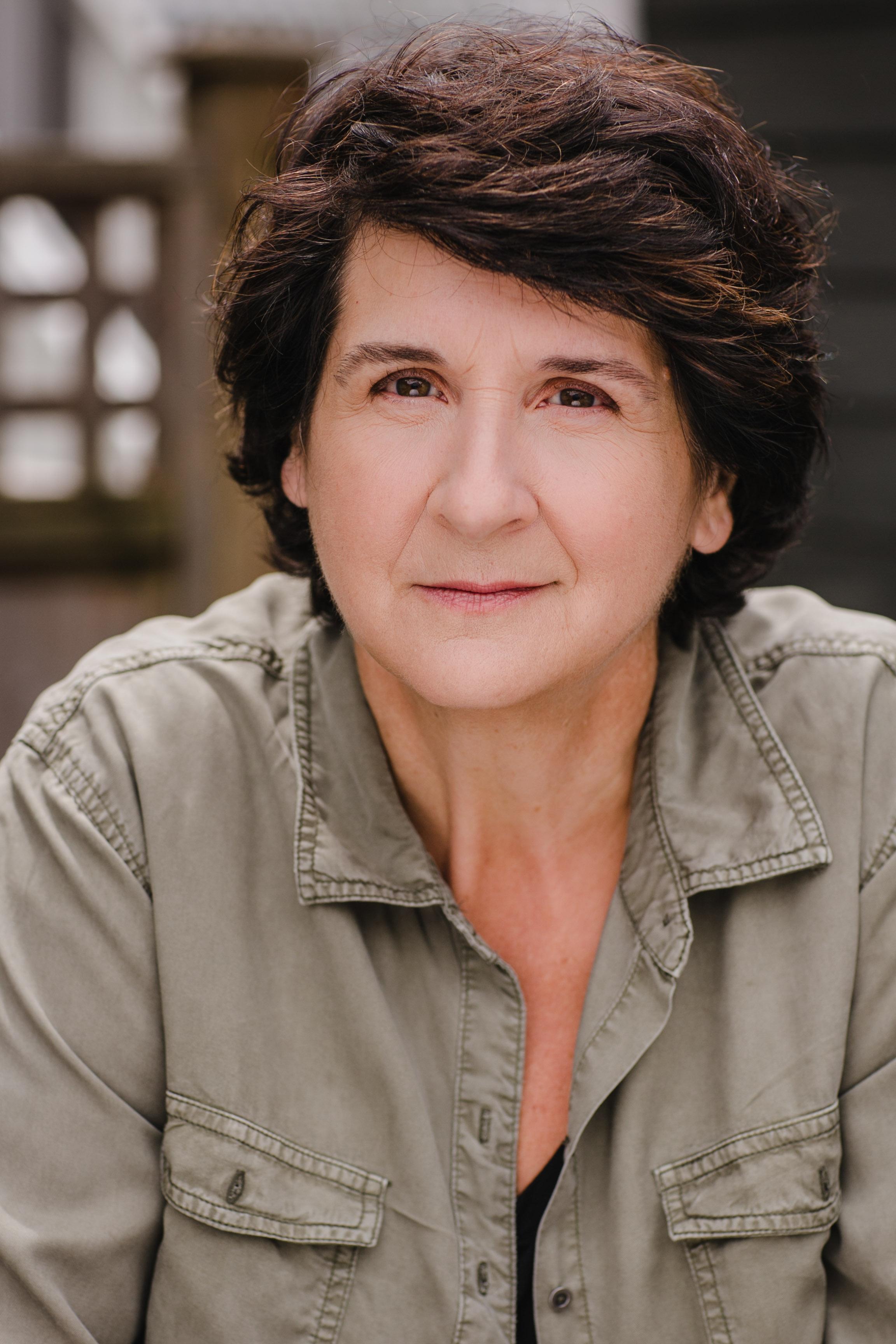 Pam Kearns as Sylvia Patrick, Martha, University Dean
