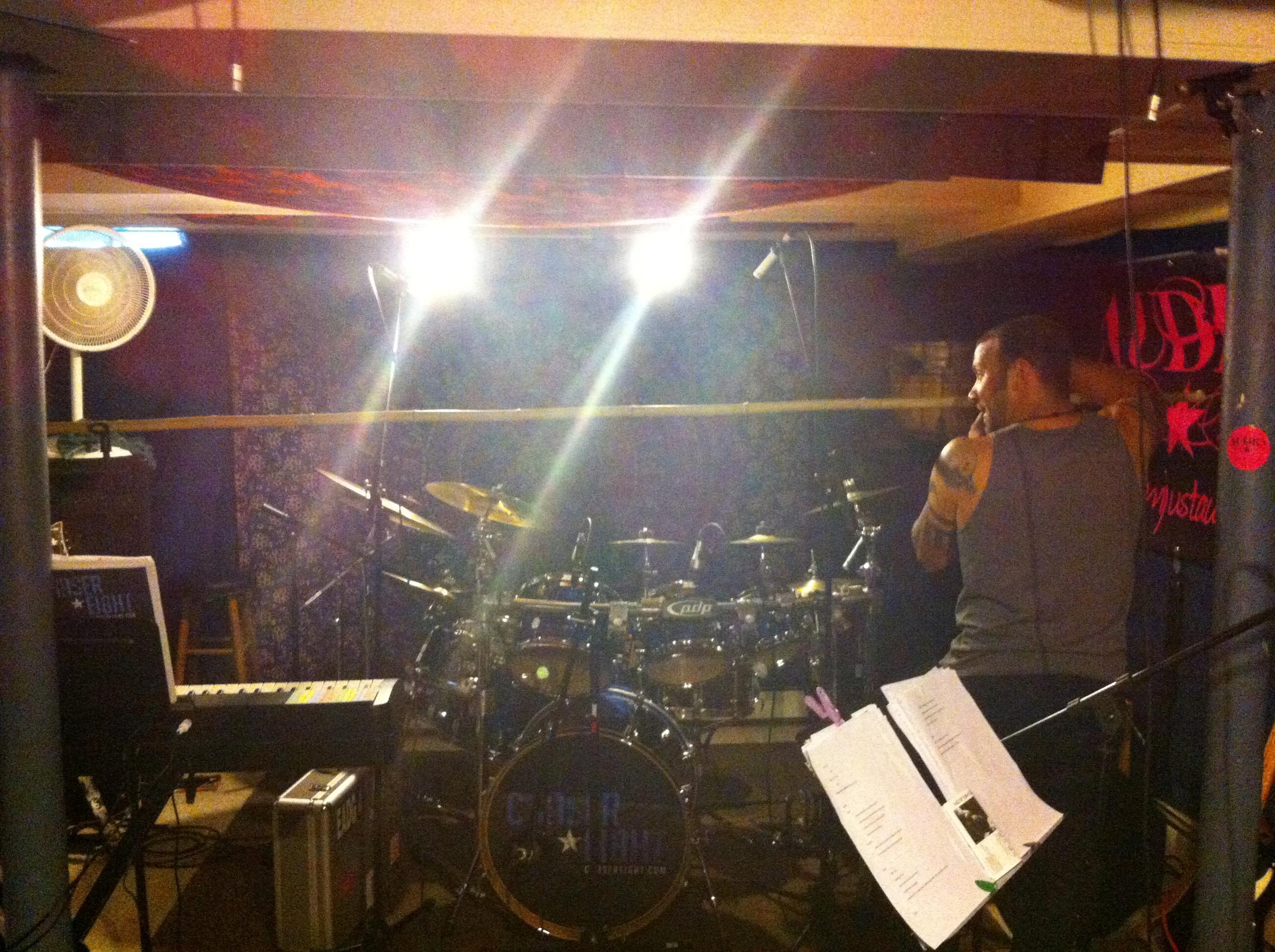 Keyboardist/guitarist Aaron Tagliamonte setting up our custom drum shield.