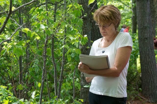 Mary Ann Johnson recording observations during the silent nature hike.