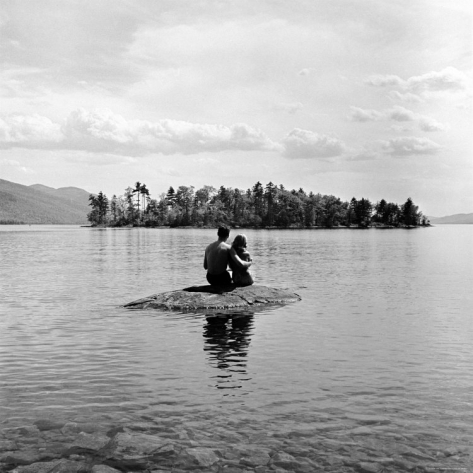 nina-leen-young-couple-embracing-on-small-rock-protruding-from-the-waters-of-lake-george_i-G-27-2760-9U2TD00Z.jpg