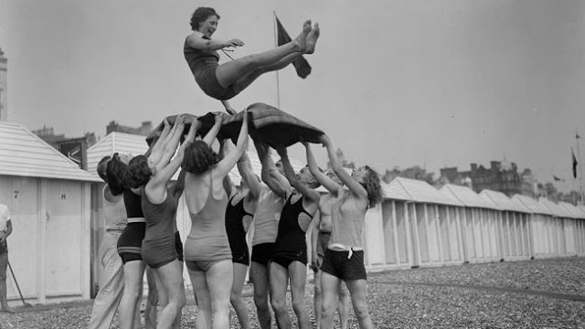 June 1930-Day trippers give the bumps to the birthday girl at Brighton seaside resort in East Sussex-Fox Photos-Getty Images.jpg