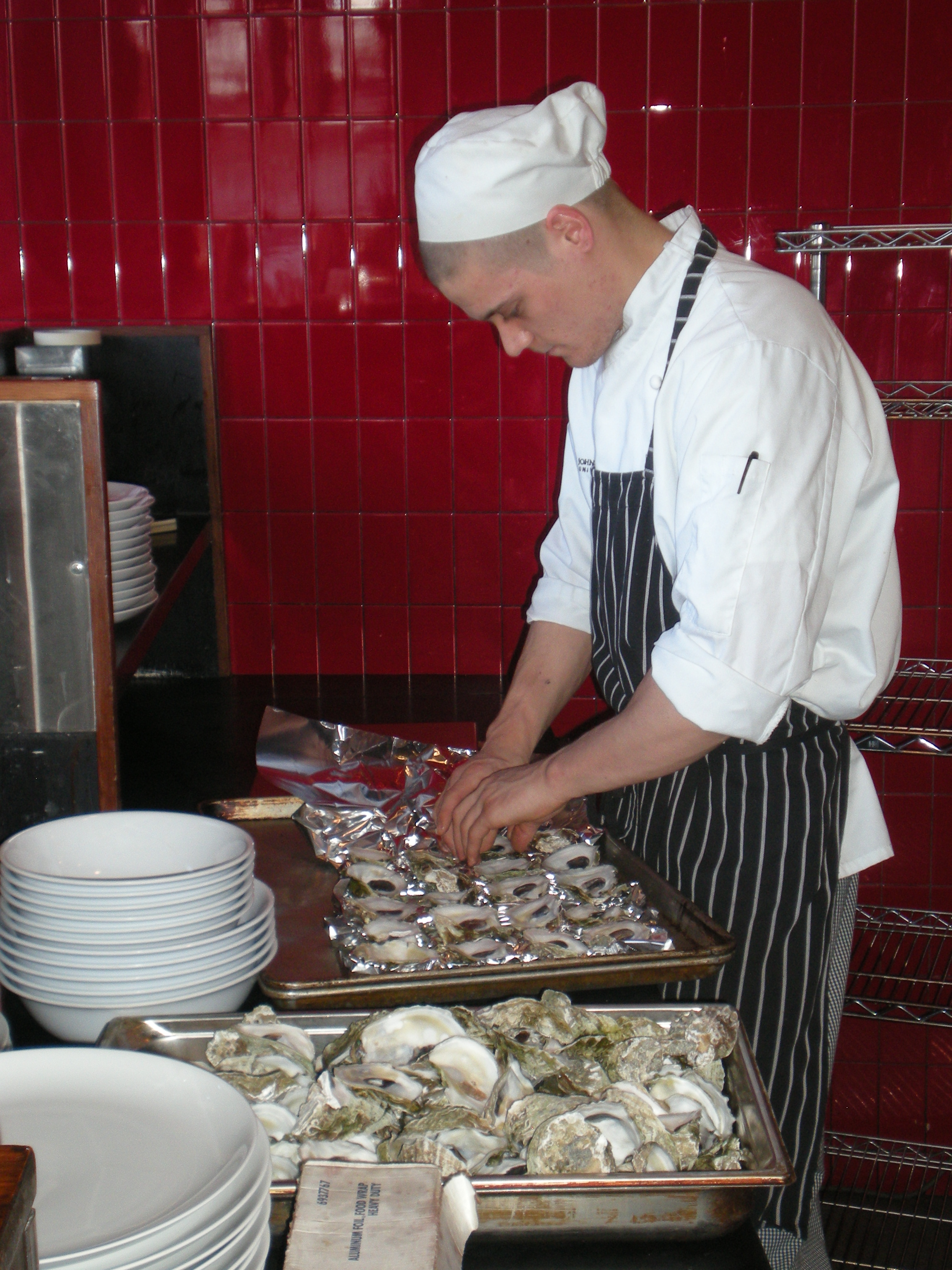 Chef at Nick's on Broadway prepares wild Narragansett Bay oysters.