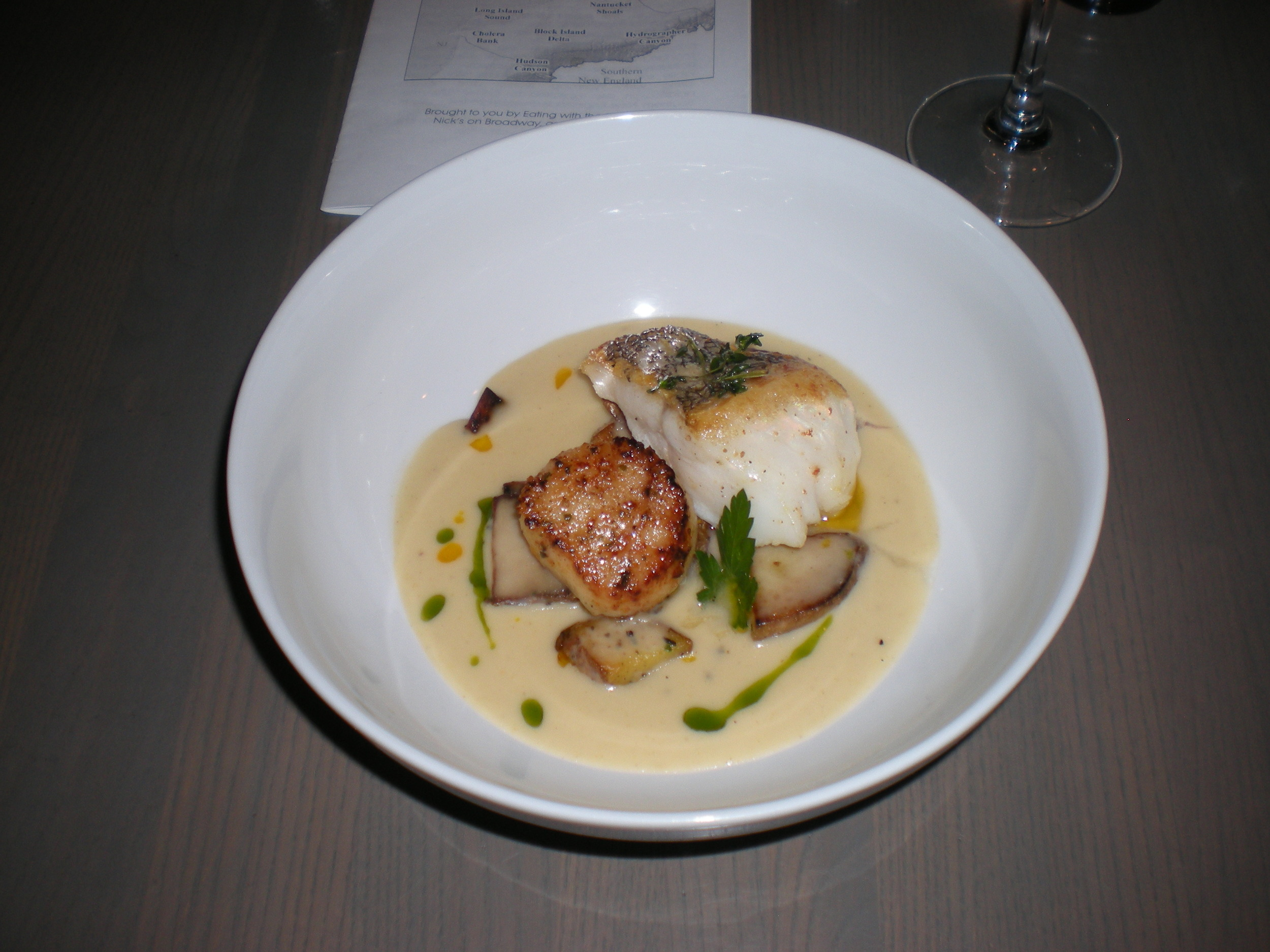 Butter-roasted Point Judith sea scallop + crispy-skin red hake with young potato, celery, lemon + thyme broth