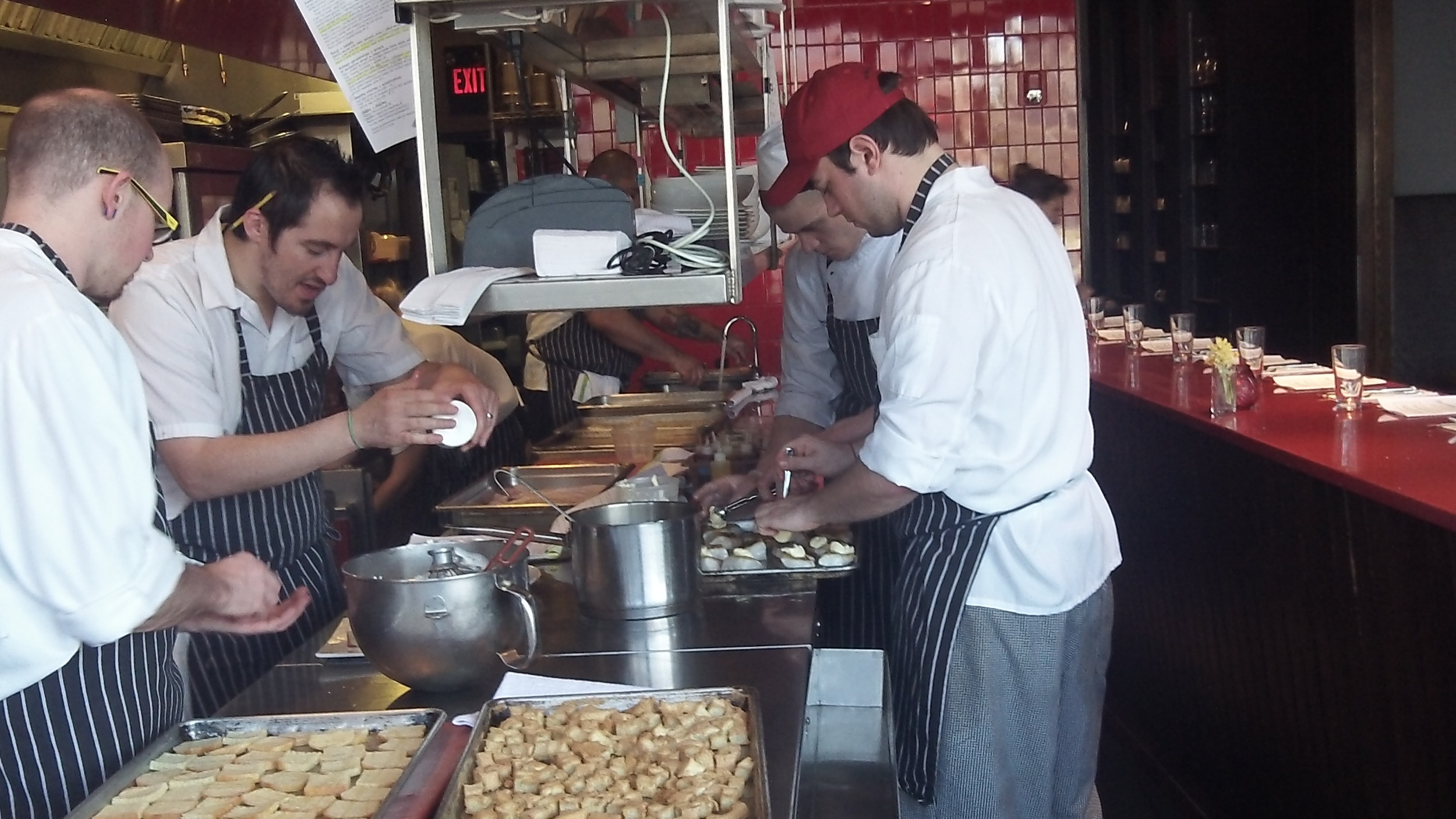 Chefs are work in the kitchen at Nick's on Broadway