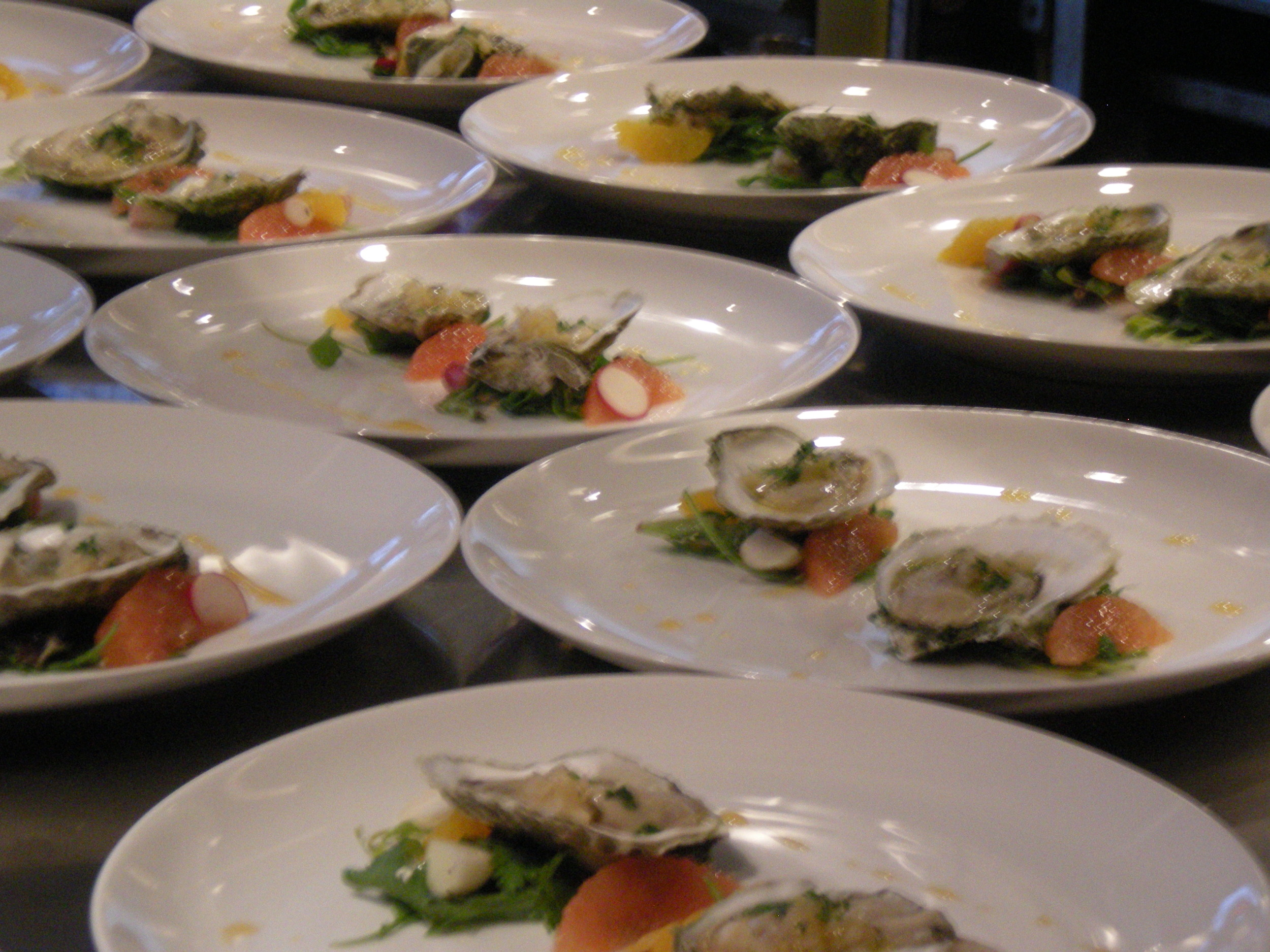 Wild Narragansett Bay oysters with early spring radishes, parsley, citrus fruits + lettuce