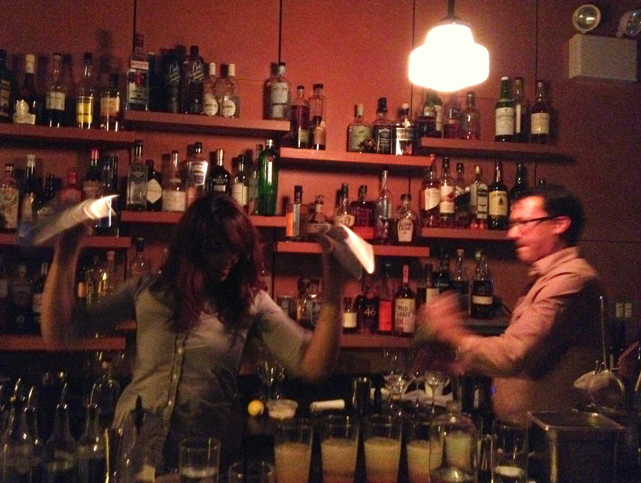 Bartenders shake the dessert cocktail, made of seaside rose hip syrup