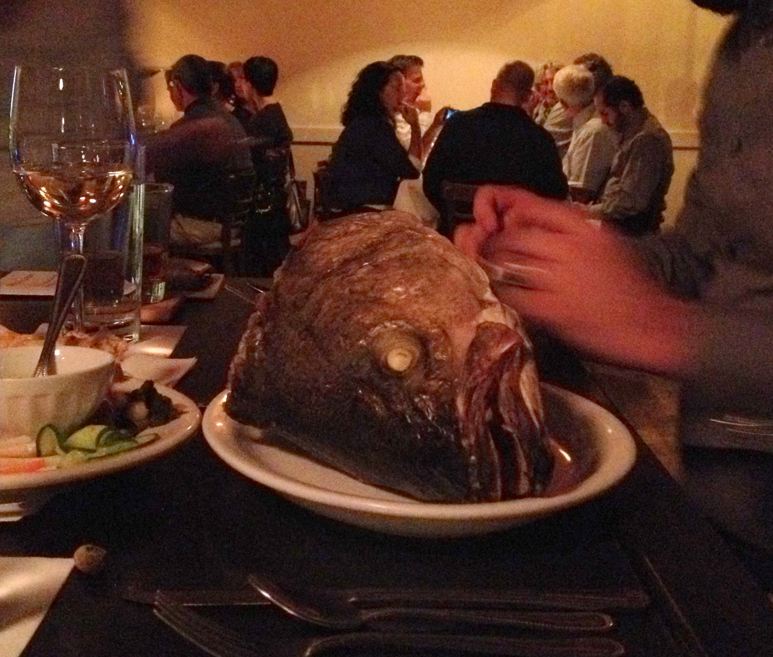 The striped bass head is served to a lucky guest