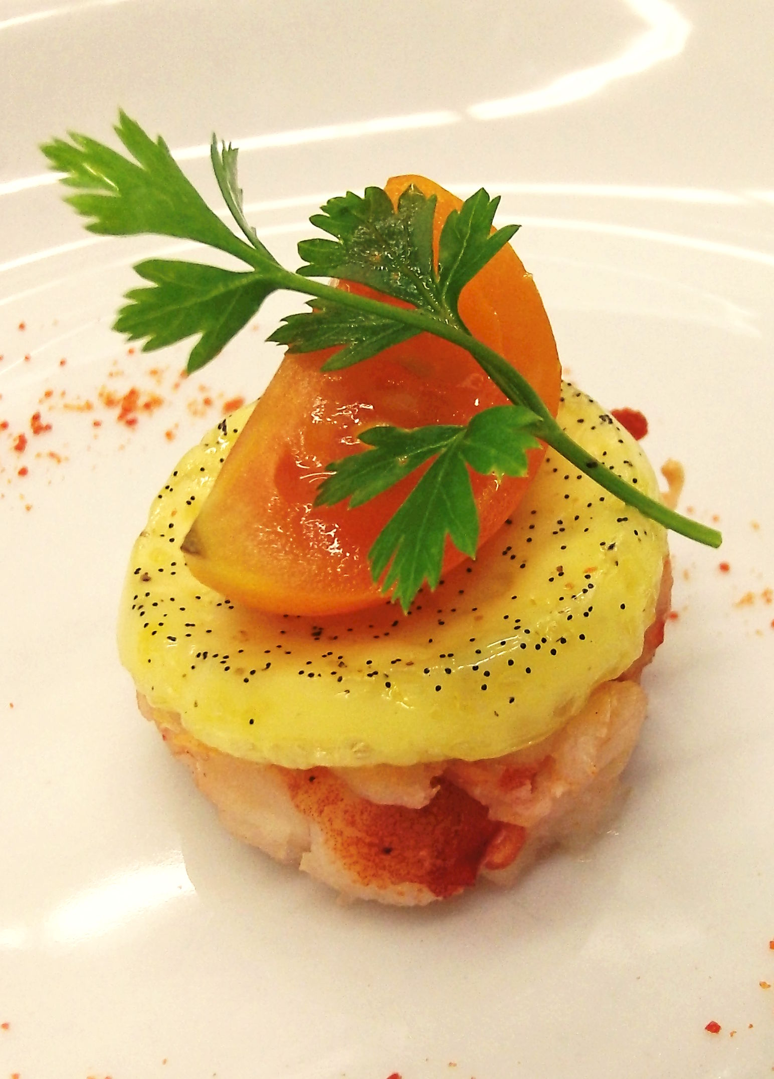 Sweet Poached Lobster Knuckle with Cardamom Vanilla Royal, Tomalley Dust, and Heirloom Cherry Tomato