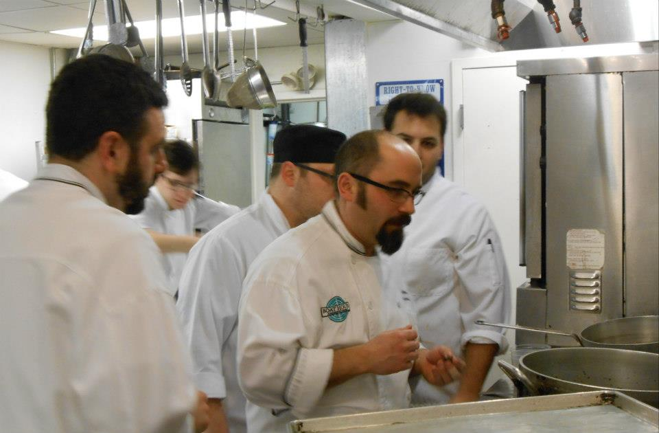 Chef Jonathan Cambra shows his team how to extract periwinkle meats.
