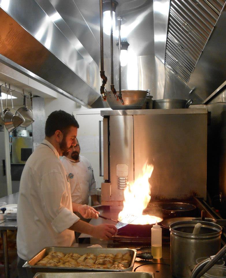 Sous chef Max Peterson cooks monkfish.