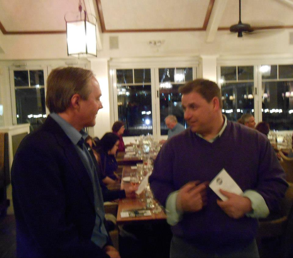 The evening's speakers get to know one another: Jeremy Collie, fisheries ecologist at the University of Rhode Island, and Billy Silvia, commercial quahogger and charter boat captain from Bristol, RI.