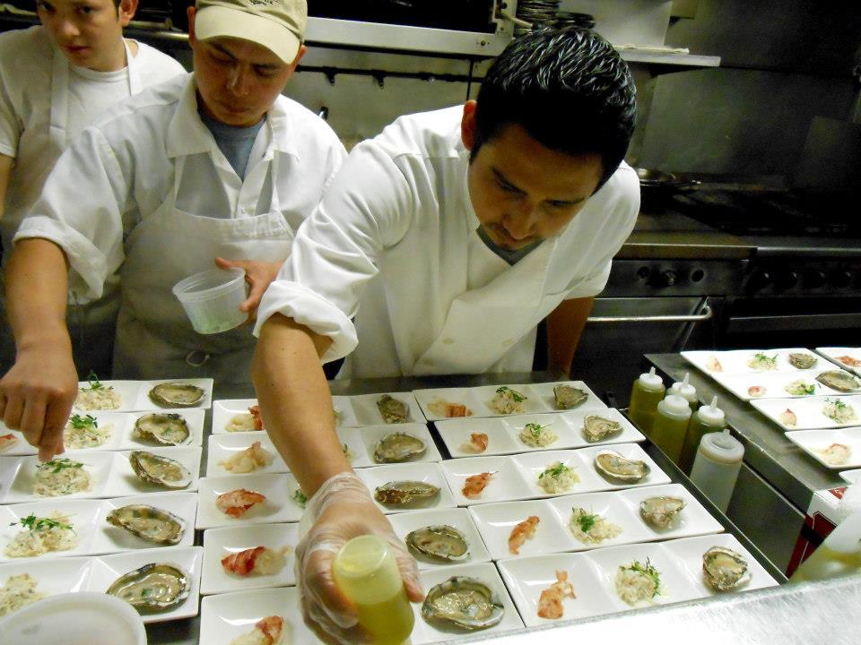 Garnishing the first course: Maine shellfish trio.