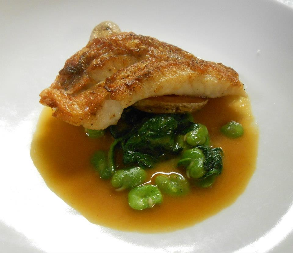 Acadian redfish with fava beans, spinach, fingerling potatoes, and shellfish tomato jus
