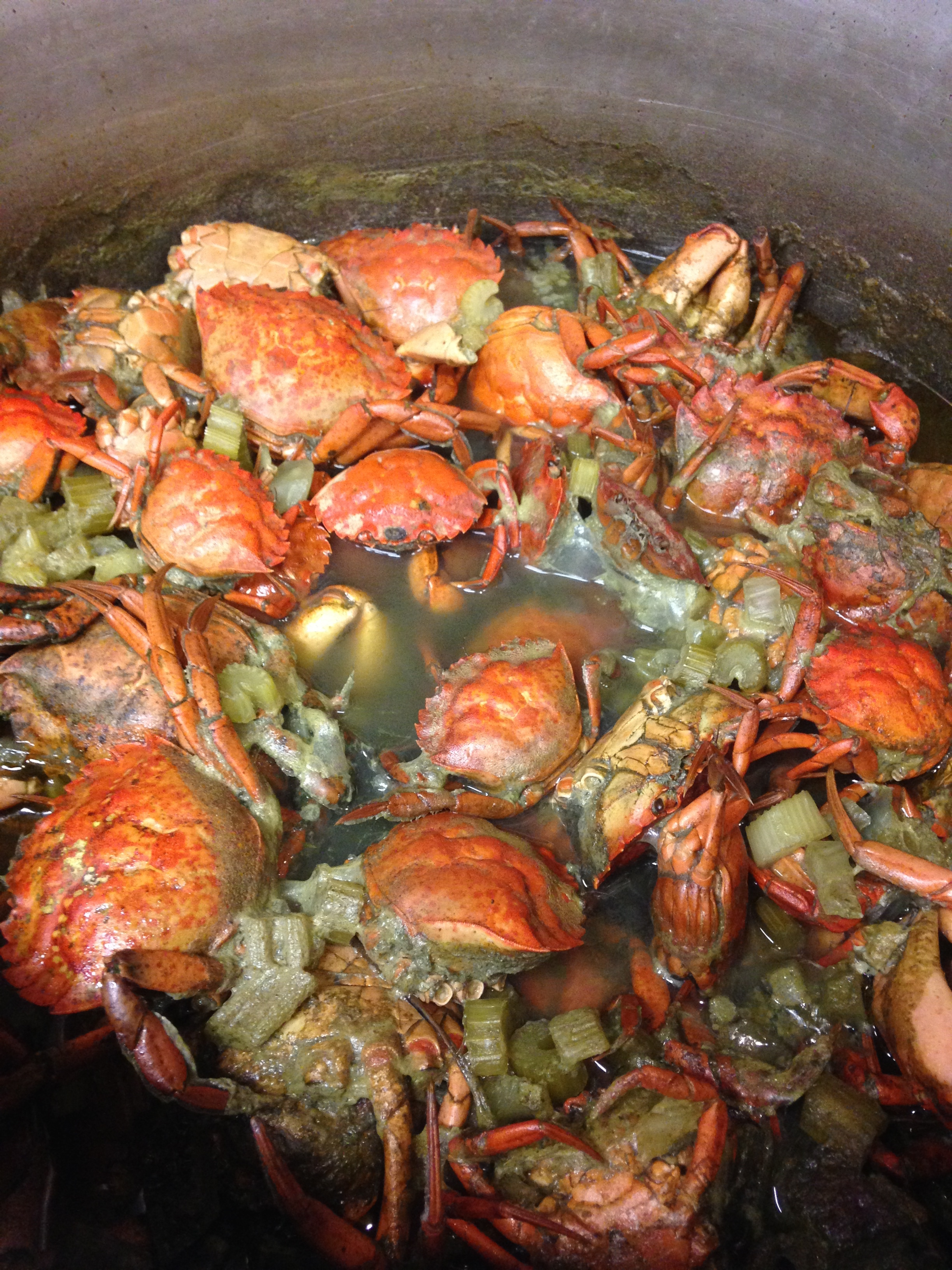 Green crabs simmering in a stock