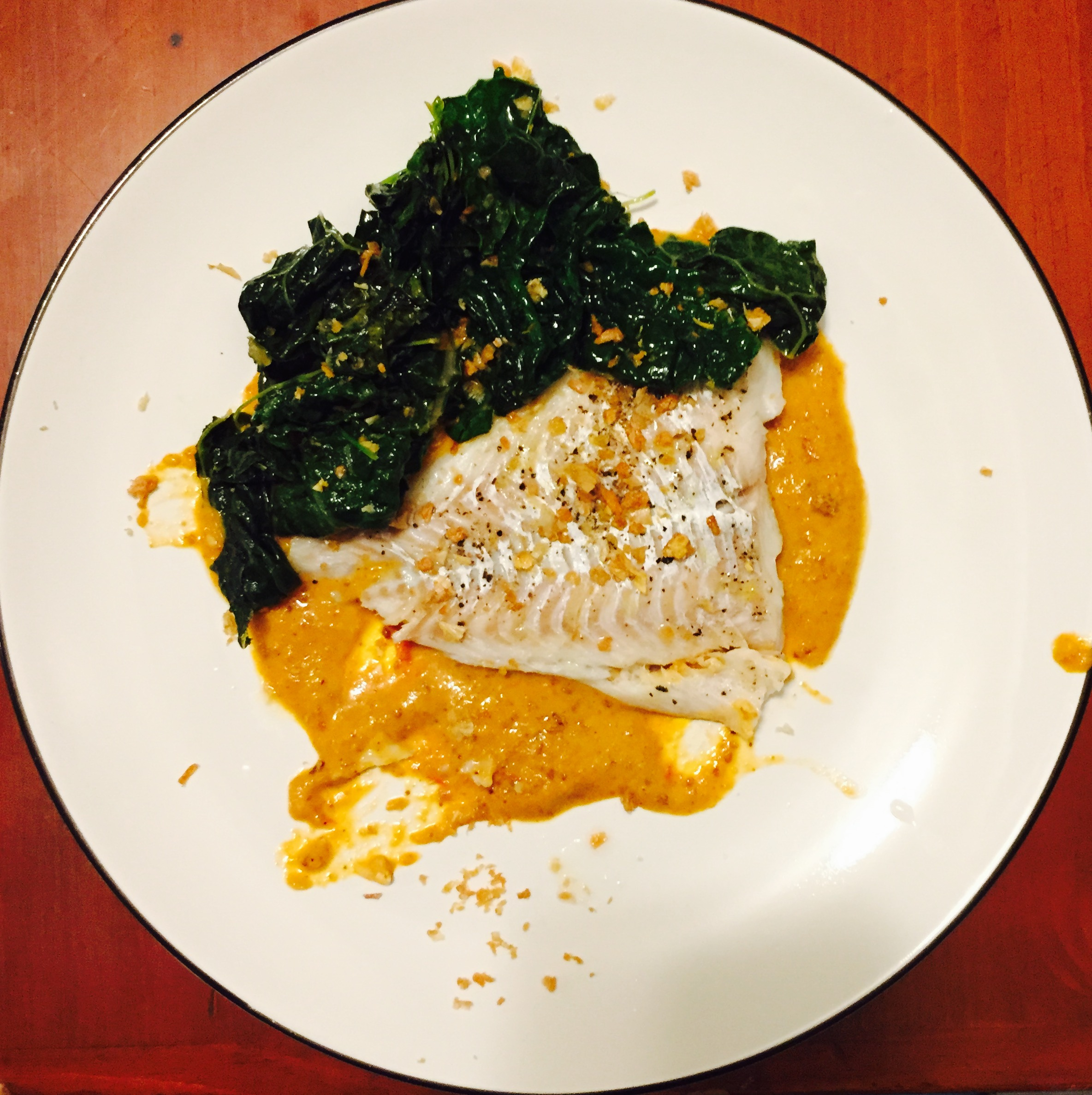 Steamed haddock with kale, bagna cauda and fried garlic.