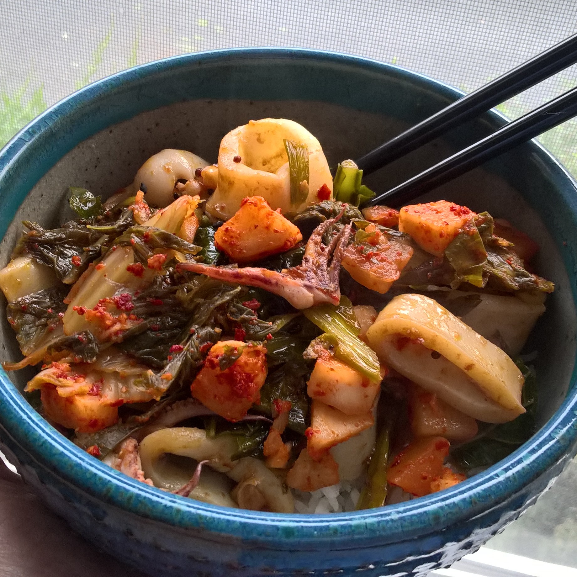 Spicy squid with greens & kimchi over rice.
