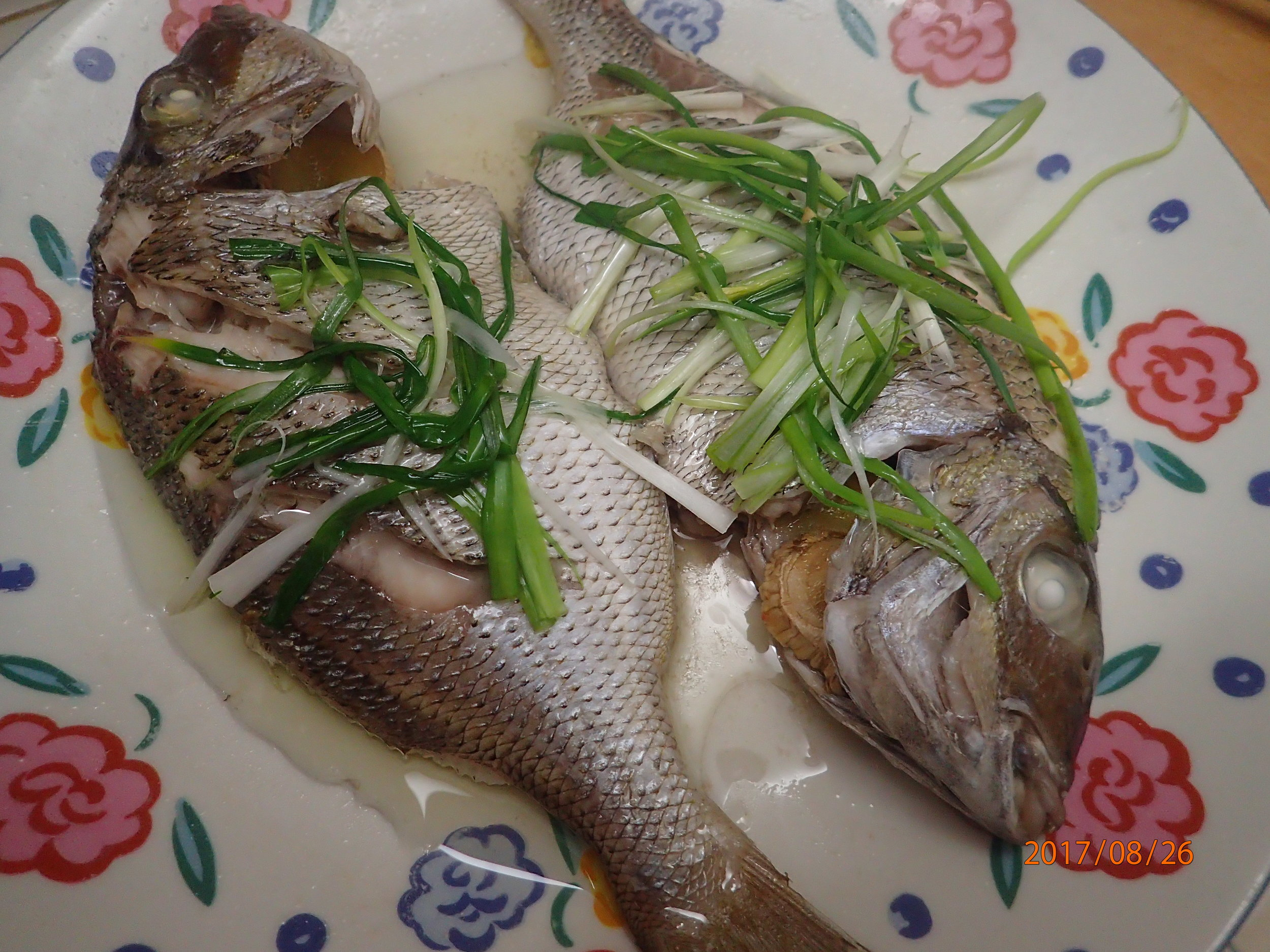 Steamed scup with scallions