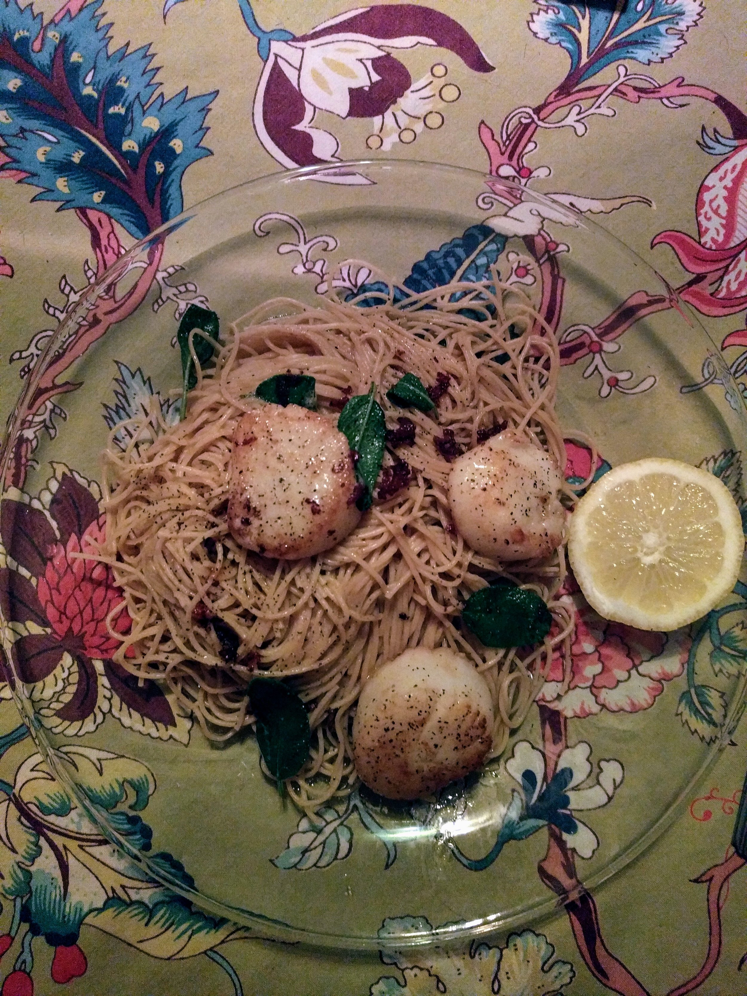 Seared sea scallops with fried sage and a brown butter sauce over angel hair pasta