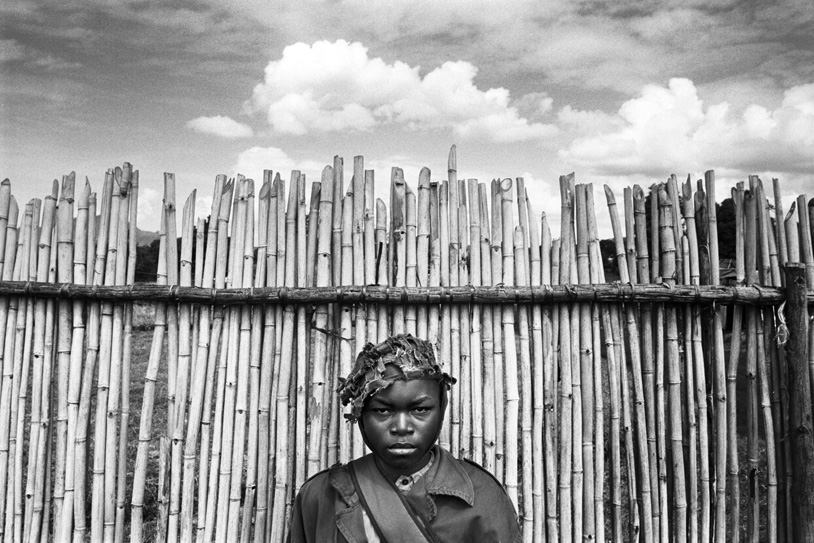 A boy soldier waits at Kpandroma's transit center. The various warring factions of the country have used children as fighters, porters, cooks, spies and sex slaves. Photo: Cedric Gerbehaye.