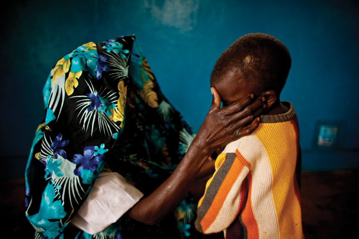 """A photograph from PROOF's exhibition """"The Legacy of Rape"""", showing a woman from the Democratic Republic of Congo and her child. Photo: Pete Muller."""