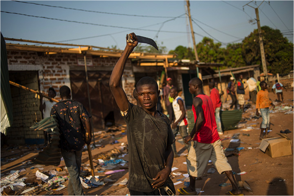 Looters in Bangui-     Photograph: Fred Dufour/AFP/Getty Images; Source: The Guardian