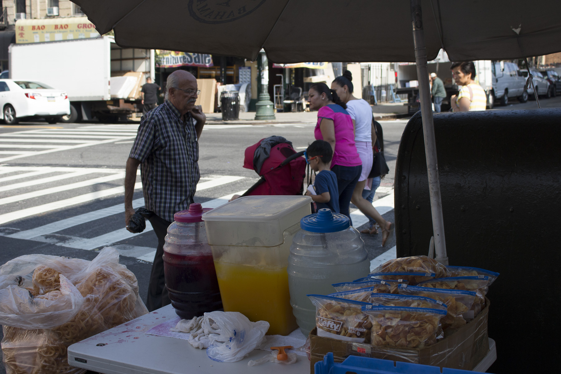 A view of the busy 5th and 56th street corner on a hot 22nd of August, 2017. Pictured is her homemade potato chips, limonada, jugo de mango, and jamaica.