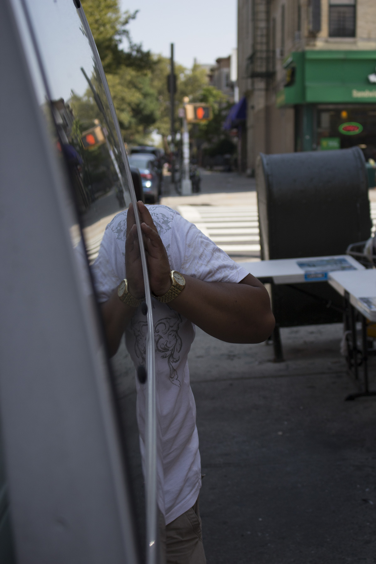 Sergio gets supplies from their truck on the 22nd of August, 2017 in Sunset Park, Brooklyn.