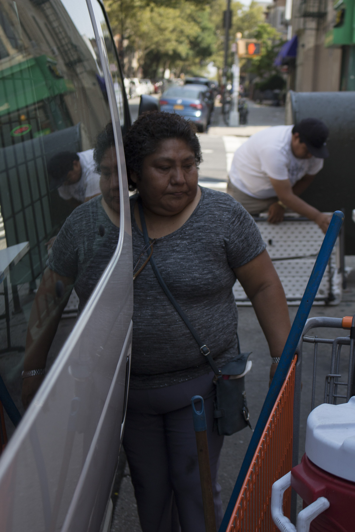 Teodosia unpacks her truck each day in Sunset Park, Brooklyn. On August 22nd, 2017, she had the help of her son Sergio.