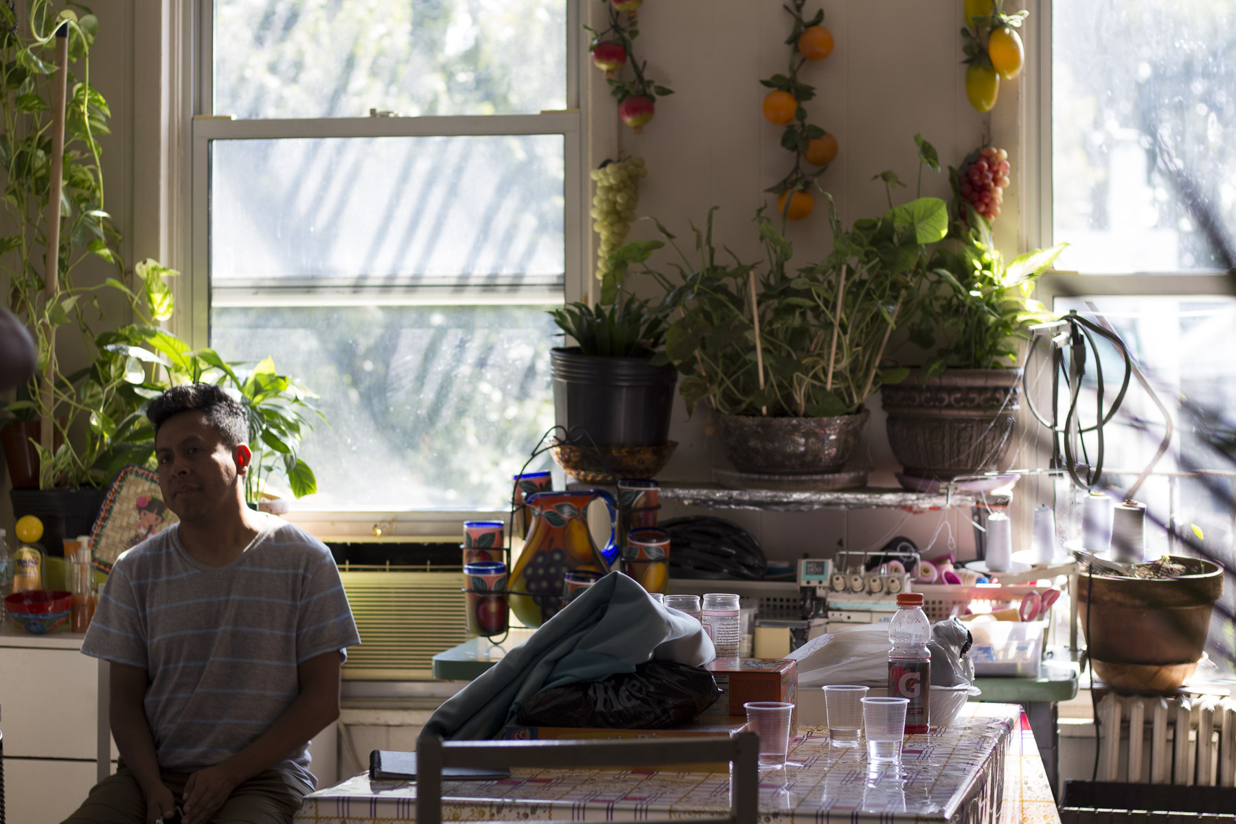 Benito Bravo sits in his kitchen which doubles as his work space for creating costumes. Gabrielle Narcisse and Deleelah Saleh for Picture Justice. August 22, 2017, Sunset Park.
