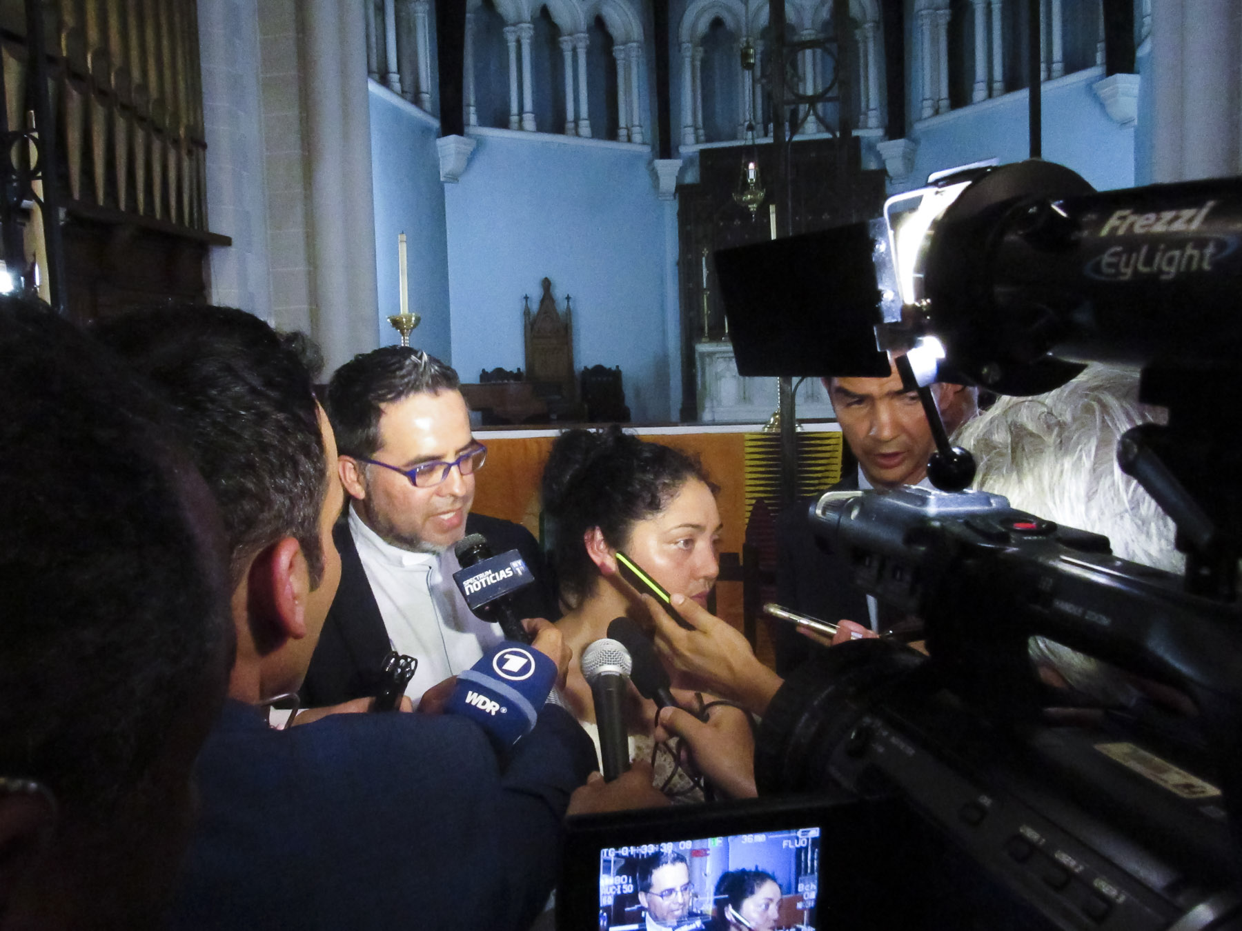 The New York Sanctuary Coalition works to protect the rights of undocumented immigrants across New York by providing legal counseling as well as offering sanctuary in throughout across the city. Head minister, Juan Carlos Ruiz, seeks to educate the media about the Coalition's advocacy in a press conference. Holyrood Episcopal Church in Washington Heights, New York – August 17, 2017.