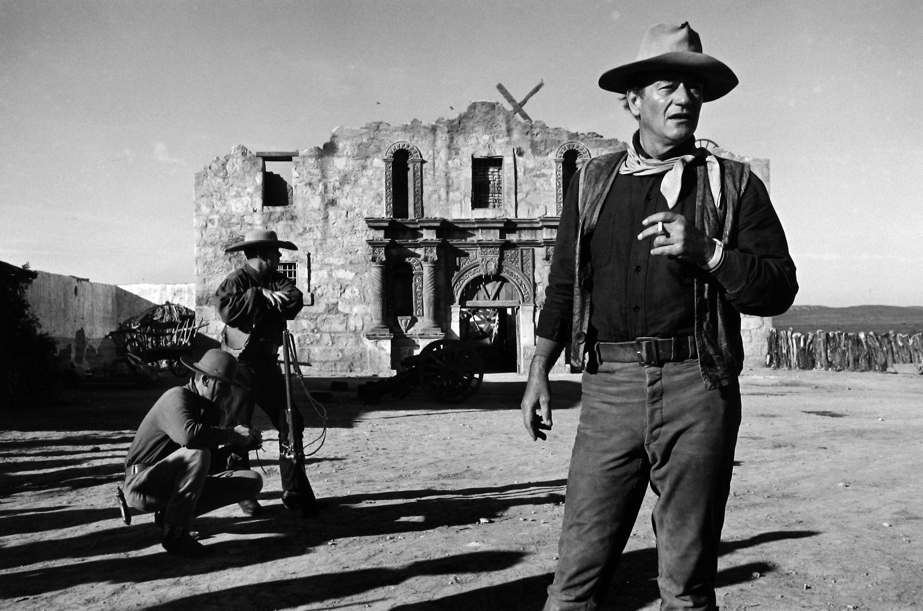 """John Wayne on set of """"Alamo""""  Gel silver print   DENNIS STOCK (1928-2010)    Dennis Stock, a native New Yorker and a Navy veteran, became an apprentice to Life magazine photographer Gjon Mili in 1947; 4 years later he entered a Life magazine contest for young photographers and won first prize for a series on immigrants. He joined Magnum Photo Agency in 1951, remaining a lifelong member. Stock managed to evoke the spirit of America through his memorable portraits of Hollywood as well as the jazz scene, most notably for his iconic photos of James Dean."""