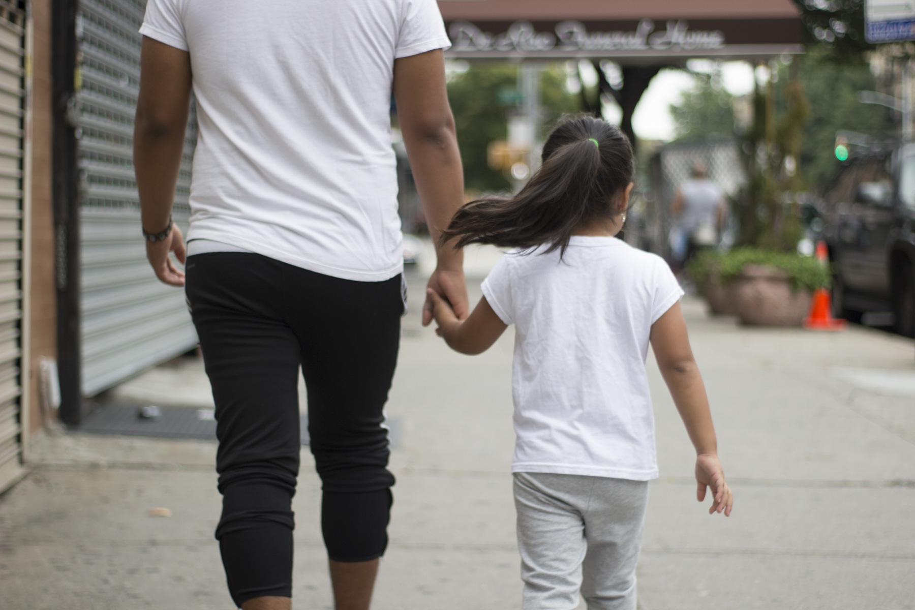 Carlos walks his younger sister to school. August 22, 2017