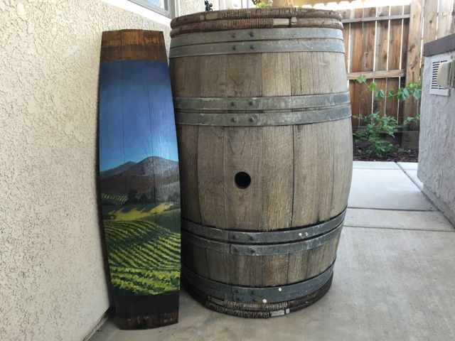 This photo helps depict the size of the wine barrel paintings.