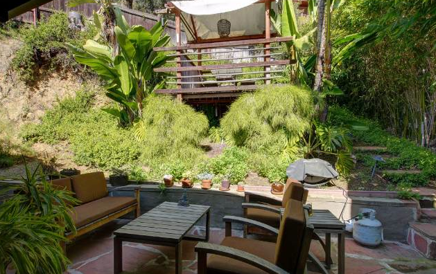 """Per the listing there are 2 patios and a """"treehouse."""""""