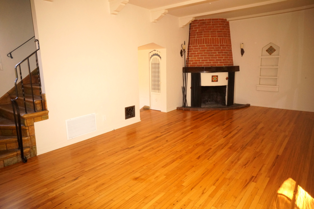 Living Room With Working Wood-Burning Fireplace