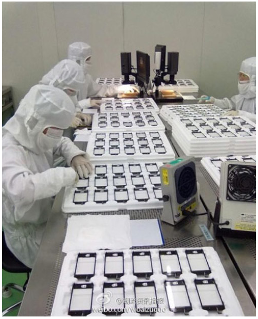 From  Electronista :    A photo from a Wintek plant captured by a Weibo user has supported beliefs the iPhone 5 will have at least some design changes. Touch panels going through the contractor's quality assurance process support views that the next iPhonewill have a larger screen . Along with the screen itself appearing bigger, the home button appears to now be an oval and suggests Apple might have 'squashed' the control, either to fit the larger screen or to accommodate interface needs.     Fits with other rumors, though it's still hard for me to believe it fits with Apple's plans. We'll likely see soon.