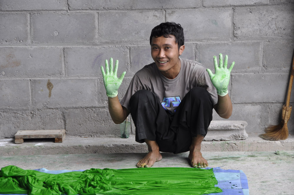 Worker wearing gloves to protect hands while smocking