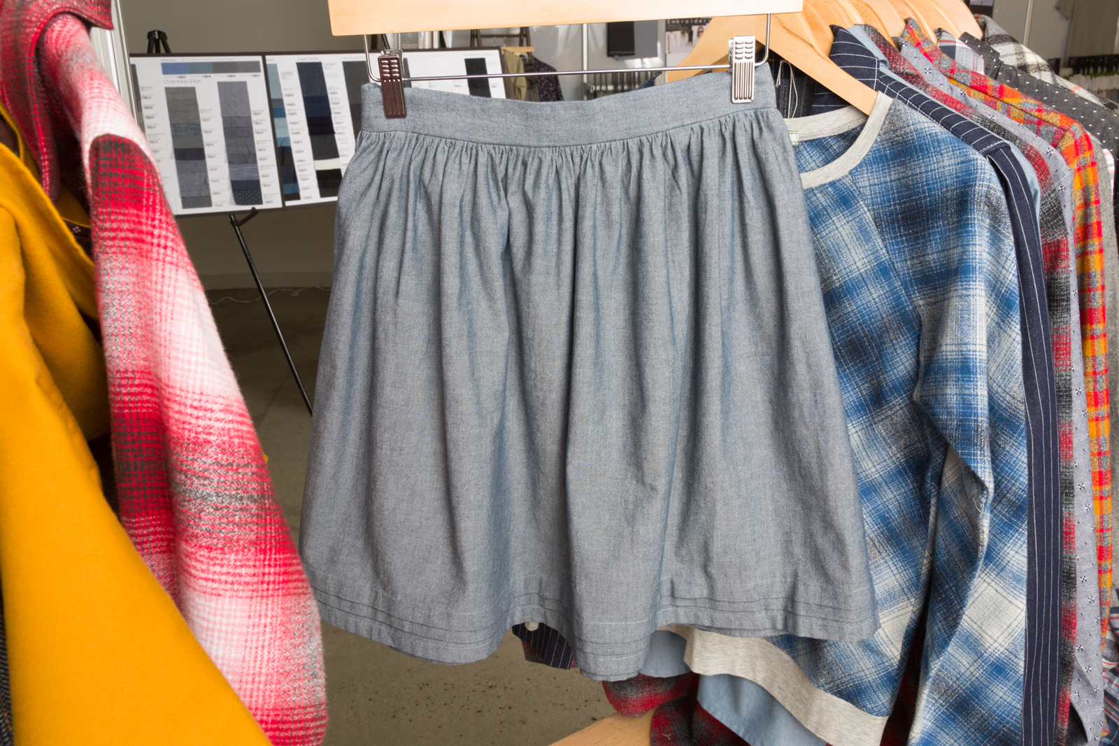 Paris Skirt   by   Nothing too Fancy  , made by   Christine Haynes,   , featuring   Chambray Union      Linden Sweatshirt   by   Grainline Studio ,  made by   Andrea Taddicken  , featuring     Mammoth Flannel .