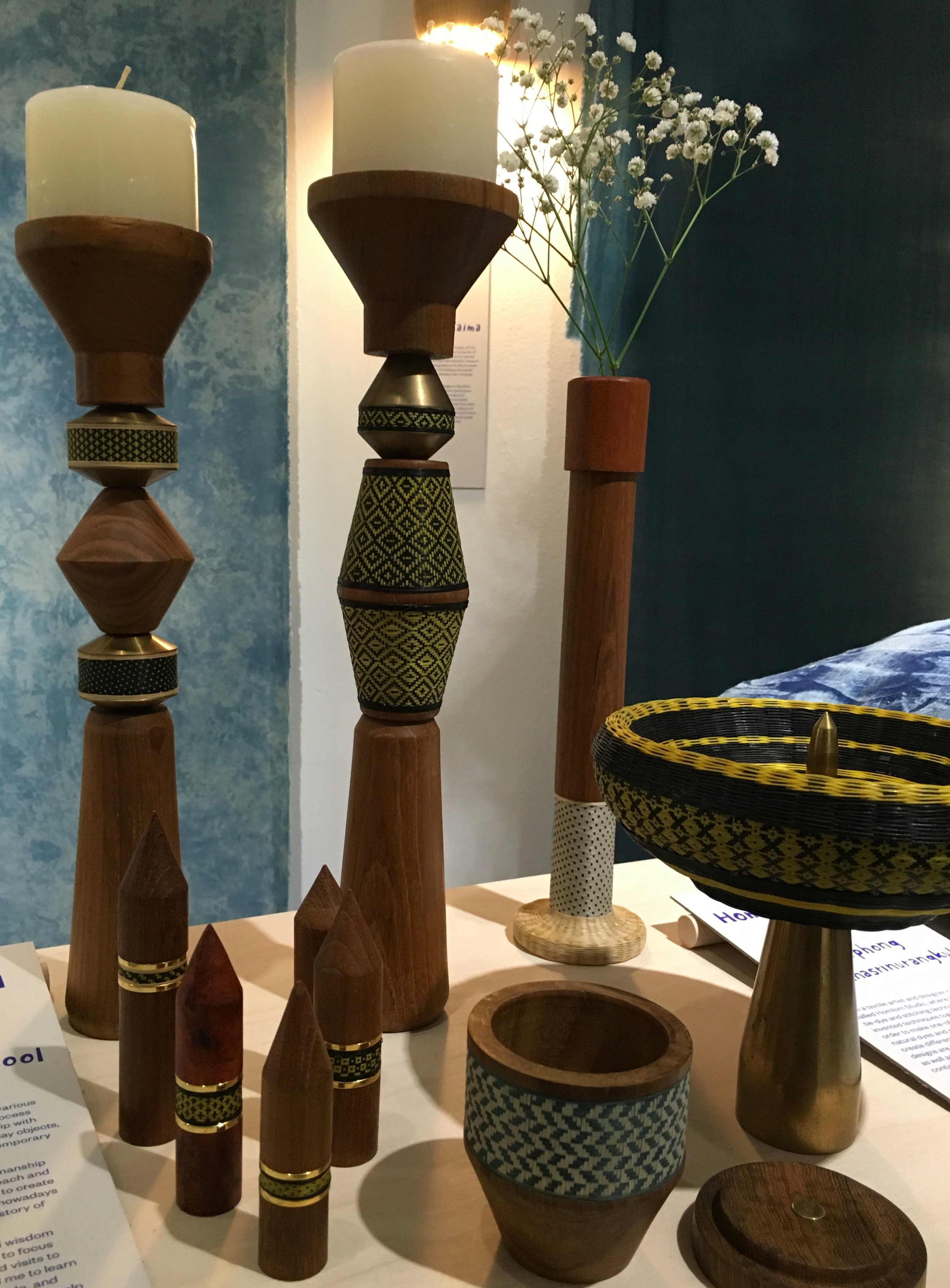 Pillar Candlesticks, rings and vessels from Thai designer-makers  Patapian .  Combining Thai wicker weaving techniques with other local craft skills.
