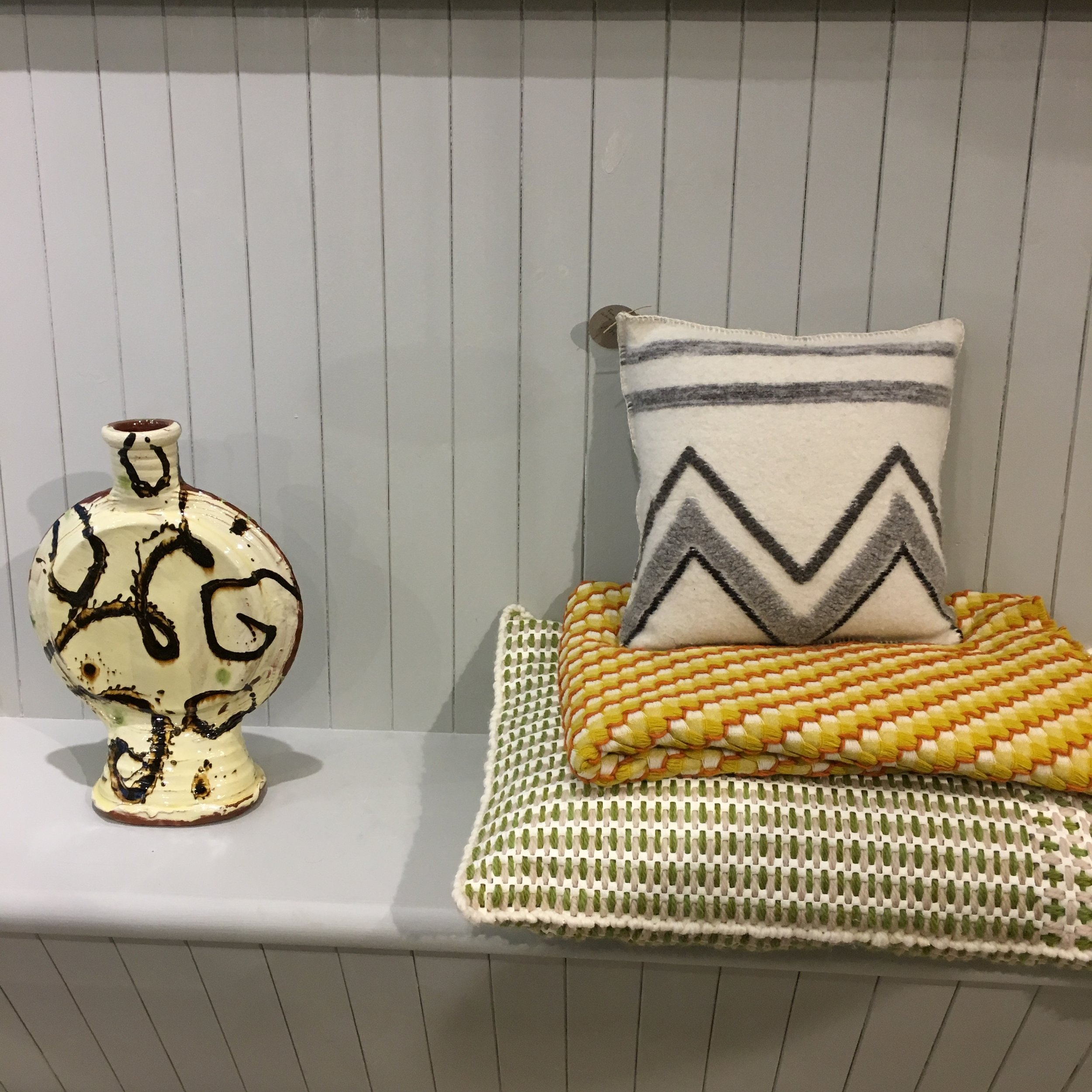 Slipware bottle by Dylan Bowen, cushions by The Good Shepherd and Kim Norrie